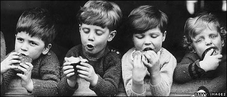 Children eating hot cross buns