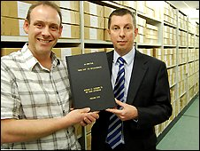 Andy Whittaker (left) presents the unofficial Who's Who to the Nottinghamshire Archives