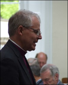 Bishop Bob praying