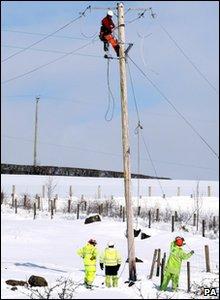 Northern Ireland Electricty (NIE) repair snow damaged lines in Cargan in Co Antrim