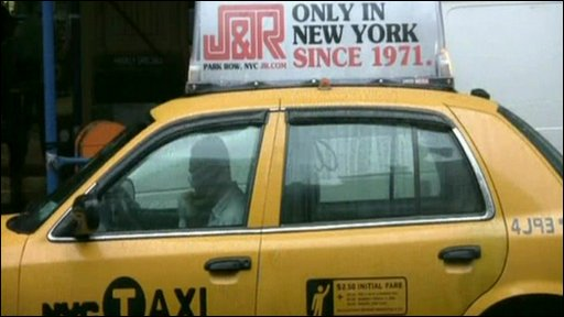 An advertising box on top of a New York taxi