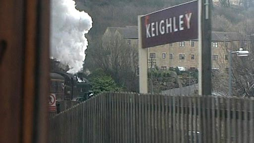 Steam train pulling into Keighley