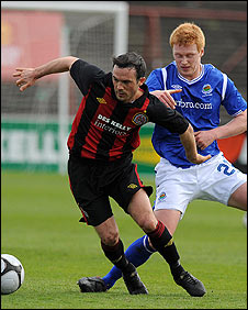 Brian Shelley of Bohemians holds off Linfield's Chris Casement