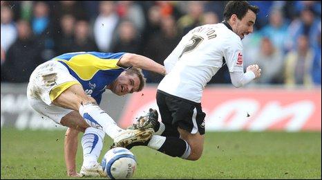 Cardiff midfielder Stephen McPhail brings down Swansea's Leon Britton