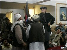 Afghan President Hamid Karzai speaks to locals during a shura in Kandahar