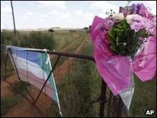 flowers are seen on a gate of the farm of Afrikaner Weerstandsbeweging (AWB) leader Eugene Terreblanche near Ventersdrop, 140km West of Johannesburg, South Africa, Sunday April 4, 2010.