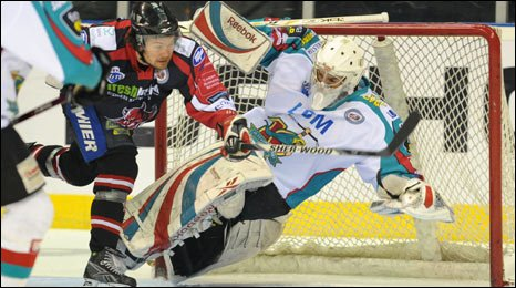 Matt Miller of the Cardiff Devils is denied by a fine save from Stephen Murphy of the Belfast Giants