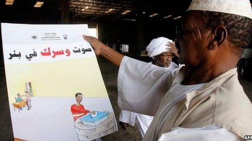 Election official looks at poster