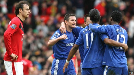 Dimitar Berbatov (left) looks on as Chelsea players celebrate
