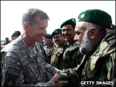 Gen Stanley McChrystal (left) inspects an Afghan National Army guard of honour during a ceremony on 25 March 2010 in Herat, Afghanistan