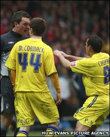 Forest goalkeeper Lee Camp confronts Cardiff pair Ross McCormack and Michael Chopra