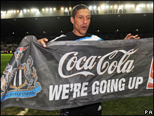 Manager Chris Hughton celebrates after Newcastle win promotion