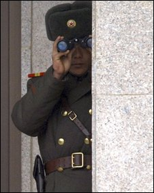 A North Korean solider watches the border