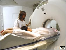 A patient going into the CT scanner