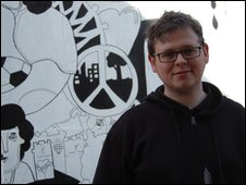 Joel Millerchip in front of his mural on Upper Orwell Street, Ipswich