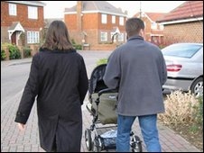 Parents pushing a pram