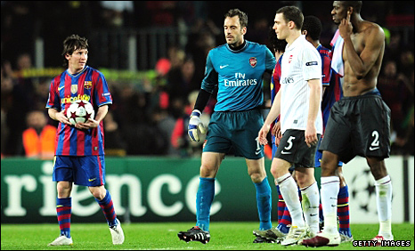 Lionel Messi (left) holds the match ball after his four goals against Arsenal