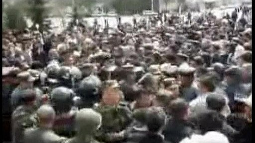 Protesters and police facing each other in Talas