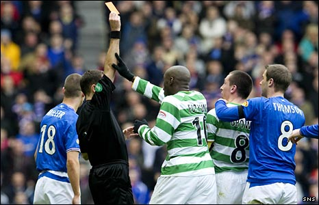 Dougie McDonald shows the red card to Celtic's Scott Brown