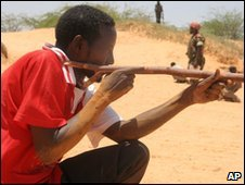 A Somali army recruit trains with a stick for a gun in Mogadishu, 30 March 2010
