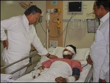 "Indian Home Minister Palaniappan Chidambaram, right, and Chhattisgarh state Chief Minsiter Raman Singh, left, visit a government soldier who was injured in Tuesday""s Maoist attack at a hospital in Raipur, India, Wednesday, April 7, 2010."