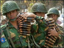 In this picture taken on February 25, 2009, Bangladeshi soldiers carry machine gun shells as they gather outside the Bangladesh Rifles headquarters complex in Dhaka.