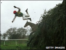 Aintree fence, jockey falling