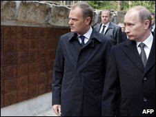 "Russian Prime Minister Vladimir Putin (r) walks with Poland""s Prime Minister Donald Tusk at the memorial museum to the Katyn massacre, 7 April 2010"