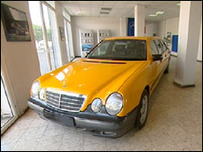 Yellow Mercedes limo in Gaza showroom
