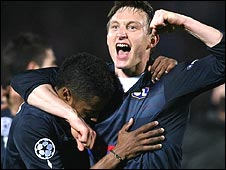 Lyon's Michel Bastos (left) and Kim Kallstrom celebrate victory