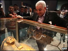 Zahi Hawass looks at a sarcophagus recently returned to Egypt by the US, in Cairo, 7 April 2010