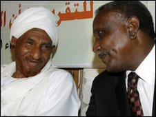 "Sudan's former prime minister and head of the opposition Umma Party Sadeq al-Mahdi (L) speaks to Yasser Arman, the southern Sudan People""s Liberation Movement's (SPLM) candidate"