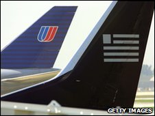 The tails of a United Airlines jet and a US Airways jet are seen at Chicago's O'Hare International Airport, file pic from 2001
