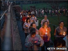 People in Whitesville, West Virginia, take part in a vigil held for the miner victims on 7 April