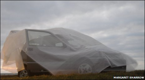 Shrouded car