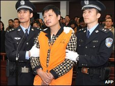 Zheng Minsheng stands as he is sentenced in Nanping, China, on 8 April 2010