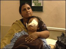 Saira Liaqat, after surgery, supported by her mother, Gulshan