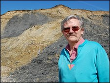 Artist and geologist Geoff Townson next to Charmouth's landslip in April 2010