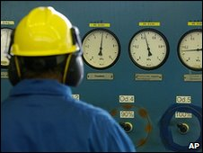 A worker checks dials at a distribution point in Poland
