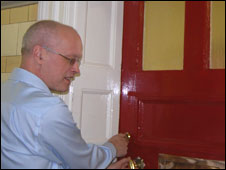 John Tomlinson unlocks the secure red door
