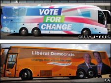 Conservative battle bus (top) and Lib Dem bus