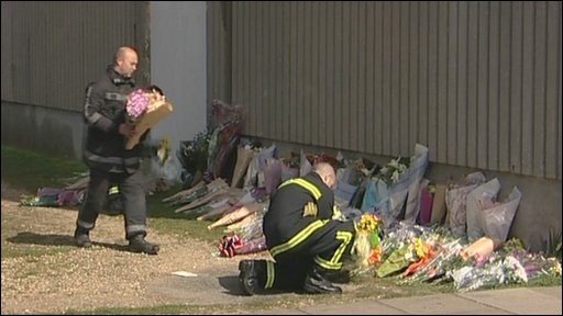 Firefighters laying floral tributes