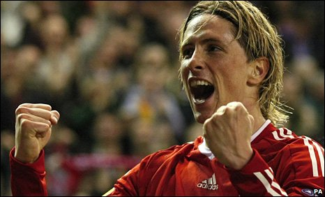 Fernando Torres celebrates after scoring against Benfica