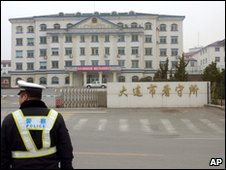 A policemand stands outside the prison on Dalian where two of the Japanese men were executed on 9 April 2010