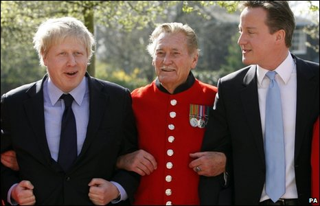 David Cameron, and London Mayor Boris Johnson talk with Chelsea Pensioners during a visit to The Royal Chelsea Hospital in London.