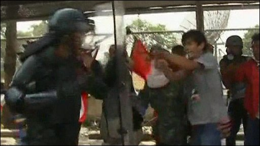 Red-shirt protesters clash with police