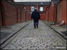 Man walking down back alley in the Bolton West constituency