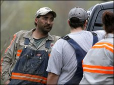 Miners talk near site of explosion