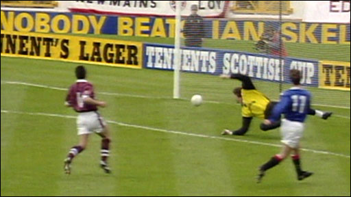 Rangers forward Brian Laudrup scores against Hearts
