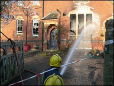 Hosing down Malvern College after a severe fire